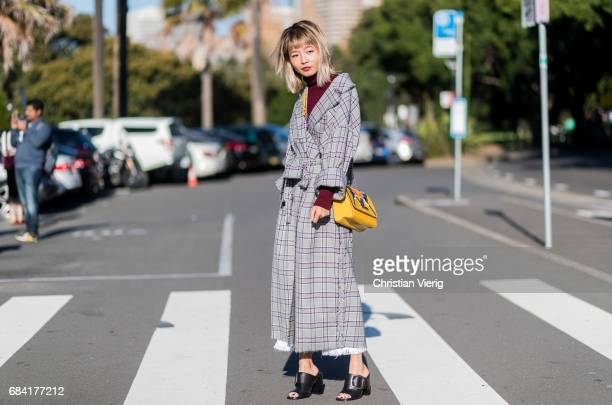 Yan Yan Chan wearing a checked coat yellow Louis Vuitton bag turtleneck outside Ginger Smart at day 4 during MercedesBenz Fashion Week Resort 18...