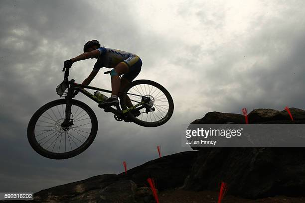 Yana Belomonina of Ukraine rides during the Women's CrossCountry Mountain Bike Race on Day 15 of the Rio 2016 Olympic Games at the Mountain Bike...