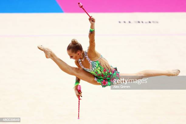 Yana Kudryavtseva of Russia performs with the clubs during the GAZPROM World Cup Rhythmic Gymnastics at Porsche Arena on March 22 2014 in Stuttgart...