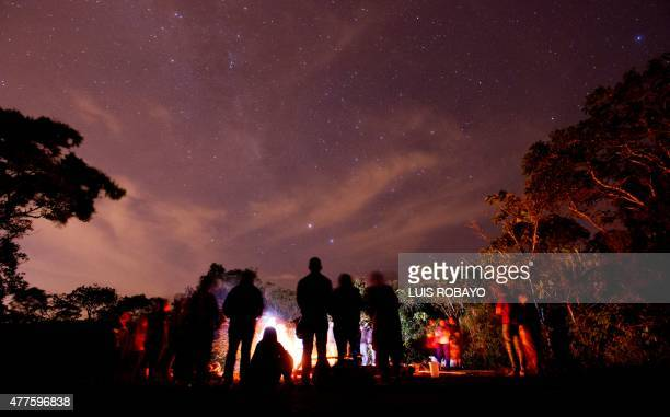 Yanacona indigenous ethnic group members perform the Yachak Yurak ritual around a fire in a rural area of Felidia Valle del Cauca department Colombia...