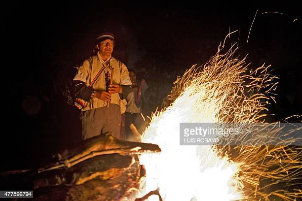 A Yanacona indigenous ethnic group shaman takes part in the Yachak Yurak ritual around a fire in a rural area of Felidia Valle del Cauca department...