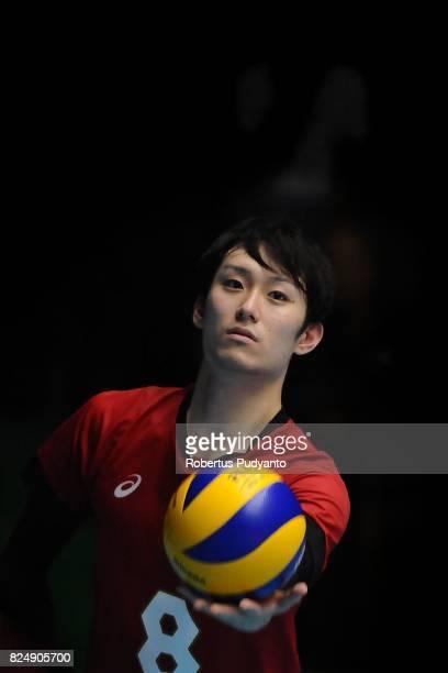 Yanagida Masahiro of Japan serves during the 19th Asian Senior Men's Volleyball Championship semifinal match between Indonesia and Japan at GOR...
