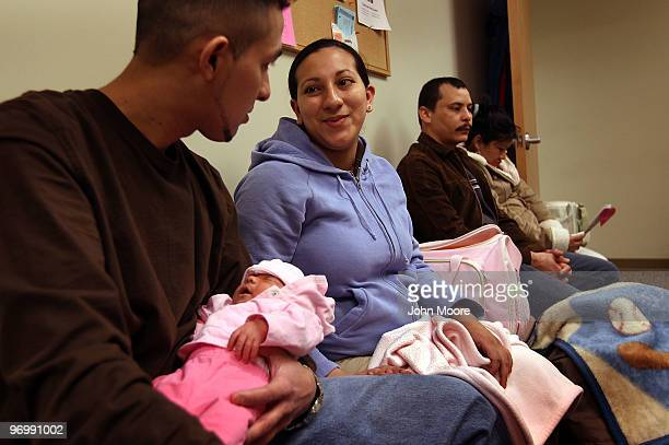 Yancy Guevara and Edwin Ayala sit with their baby Celeste during a newborn care class on February 23 2010 in Aurora Colorado The Metro Community...