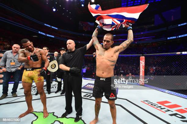 Yancy Medeiros celebrates after defeating Alex Oliveira of Brazil in their welterweight bout during the UFC 218 event inside Little Caesars Arena on...