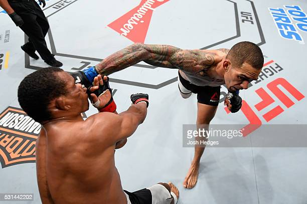 Yancy Medeiros punches Francisco Trinaldo of Brazil in their lightweight bout during the UFC 198 event at Arena da Baixada stadium on May 14 2016 in...