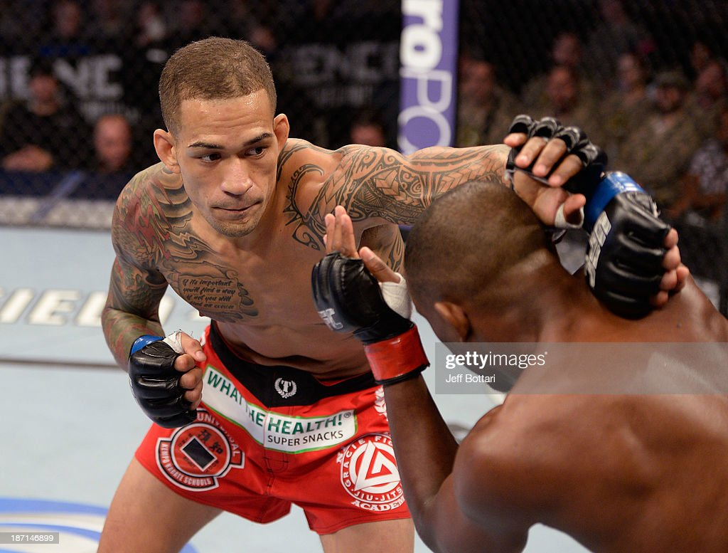 Yancy Medeiros punches Yves Edwards in their UFC lightweight bout on November 6, 2013 in Fort Campbell, Kentucky.