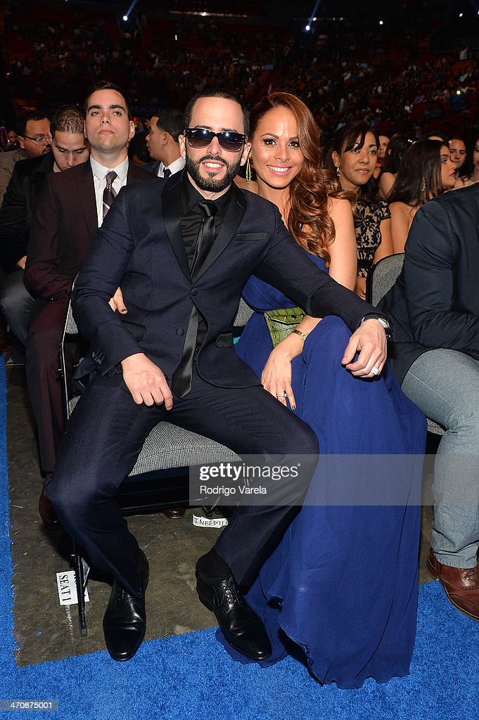 <a gi-track='captionPersonalityLinkClicked' href=/galleries/search?phrase=Yandel&family=editorial&specificpeople=666170 ng-click='$event.stopPropagation()'>Yandel</a> and Edneris Espada Figueroa attend Premio Lo Nuestro a la Musica Latina 2014 at American Airlines Arena on February 20, 2014 in Miami, Florida.