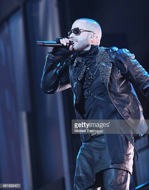 Yandel performs onstage during the 14th Annual Latin GRAMMY Awards held at Mandalay Bay Resort and Casino on November 21 2013 in Las Vegas Nevada