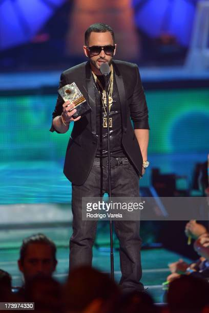 Yandel speaks onstage during the Premios Juventud 2013 at Bank United Center on July 18 2013 in Miami Florida