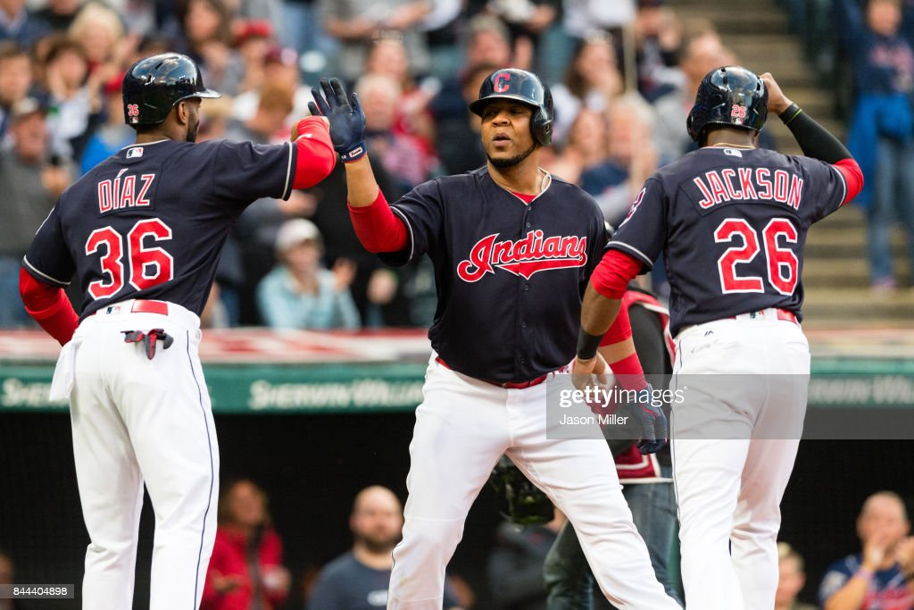 Yandy Diaz #36 and Austin Jackson #26 celebrate with Edwin Encarnacion #10 of the Cleveland Indians after all scored on a home run by Encarnacion during the first inning against the Baltimore Orioles at Progressive Field on September 8, 2017 in Cleveland, Ohio.