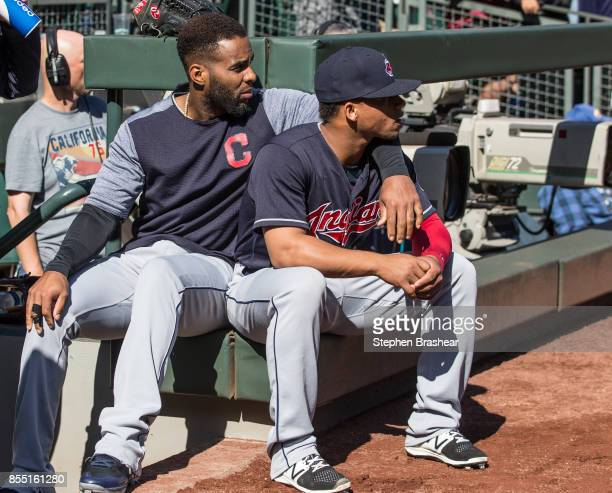Yandy Diaz left of the Cleveland Indians and Francisco Mejia of the Cleveland Indians sit outside the dugout before a game against the Seattle...