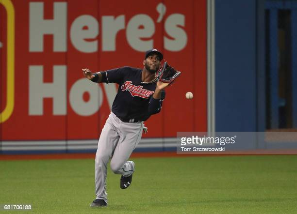 Yandy Diaz of the Cleveland Indians drops a fly ball as he makes a fielding error in the sixth inning during MLB game action against the Toronto Blue...