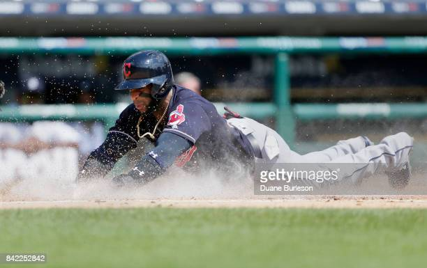 Yandy Diaz of the Cleveland Indians slides into home plate to score from second base on a single by Roberto Perez of the Cleveland Indians during the...