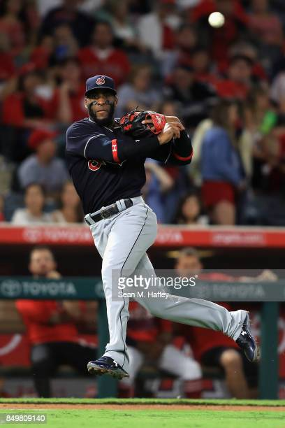 Yandy Diaz of the Cleveland Indians throws out Andrelton Simmons of the Los Angeles Angels of Anaheim on a grounder during the second inning of a...