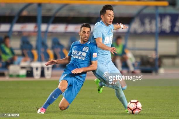 Yang Boyu of Jiangsu Suning and Eran Zahavi of Guangzhou RF compete for the ball during the 6th round match of China Super League between Jiangsu...