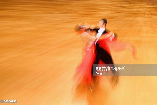 Yang Chao and Tan Yiling of China compete in the the StandardQuickstep of the Dance Sports at the Zengcheng Gymnasium during day one of the 16th...