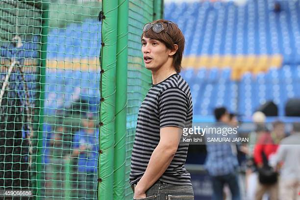 Yang Dai Kang of Hokkaido Nippon Ham Fighters looks on as he visits the practice prior to game of the IBAF 21U Baseball World Cup Final between Japan...