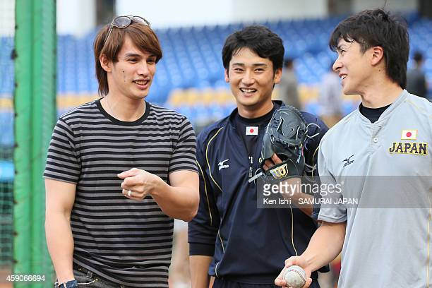 Yang Dai Kang of Hokkaido Nippon Ham Fighters talks with players of Japan as he visits the practice prior to game of the IBAF 21U Baseball World Cup...
