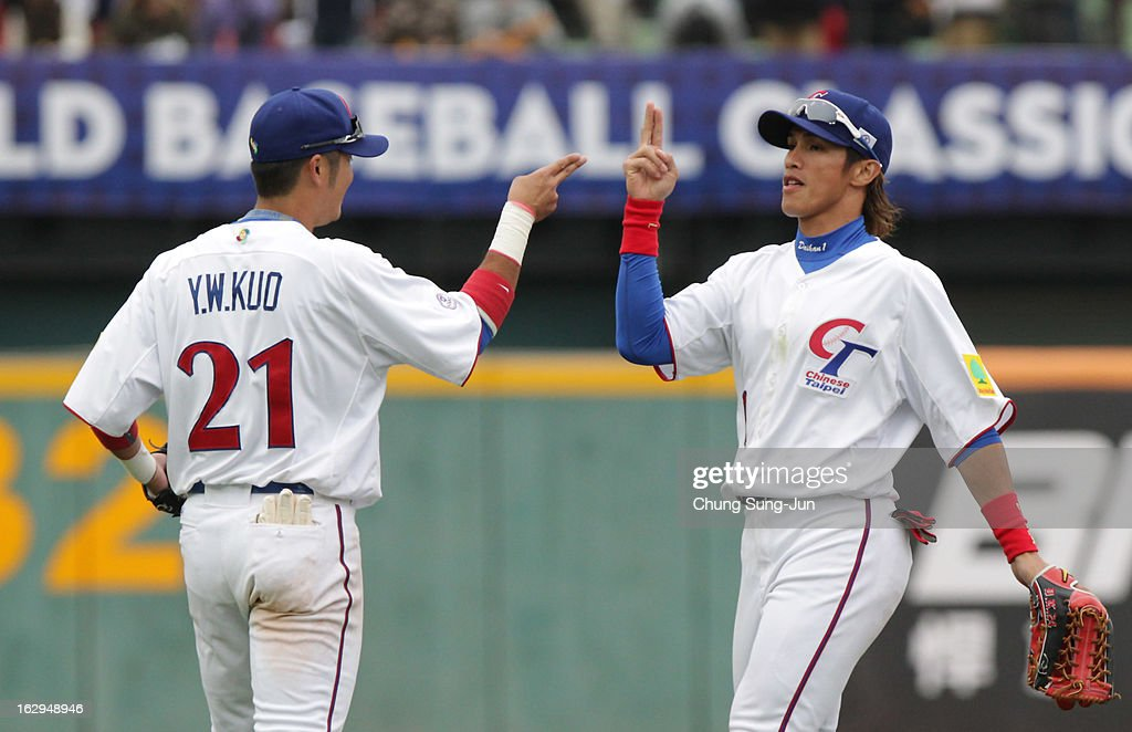 Yang Dai-Kang and Kuo Yen-Wen of Chinese Taipei celebrate after winning during the World Baseball Classic First Round Group B match between Australia and Chinese Taipei at Intercontinental Baseball Stadium on March 2, 2013 in Taichung, Taiwan.