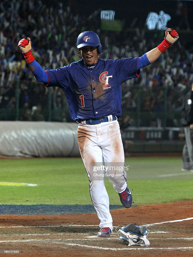 Yang Dai-Kang of Chinese Taipei celebrates in the third inning during the World Baseball Classic First Round Group B match between Chinese Taipei and South Korea at Intercontinental Baseball Stadium on March 5, 2013 in Taichung, Taiwan.