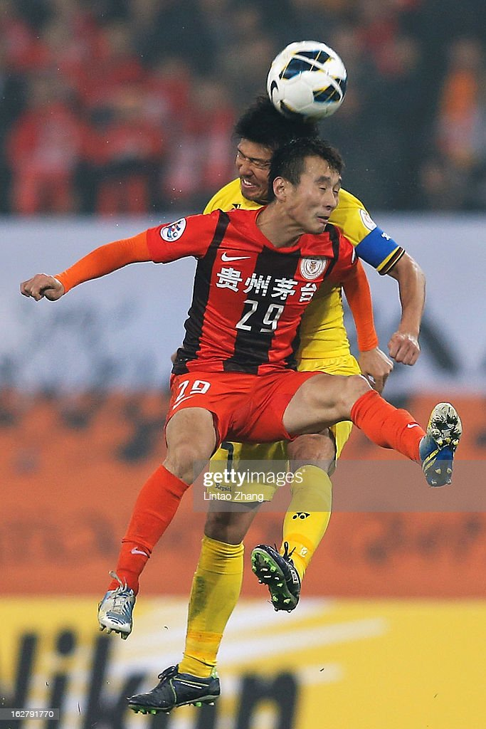 Yang Hao (#29) of Cleo of Guizhou Renhe competes for an aerial ball with Hidekazu Otani of Kashiwa Reysol during the AFC Champions League match between Guizhou Renhe and Kashiwa Reysol at Olympic Sports Center on February 27, 2013 in Guiyang, China.