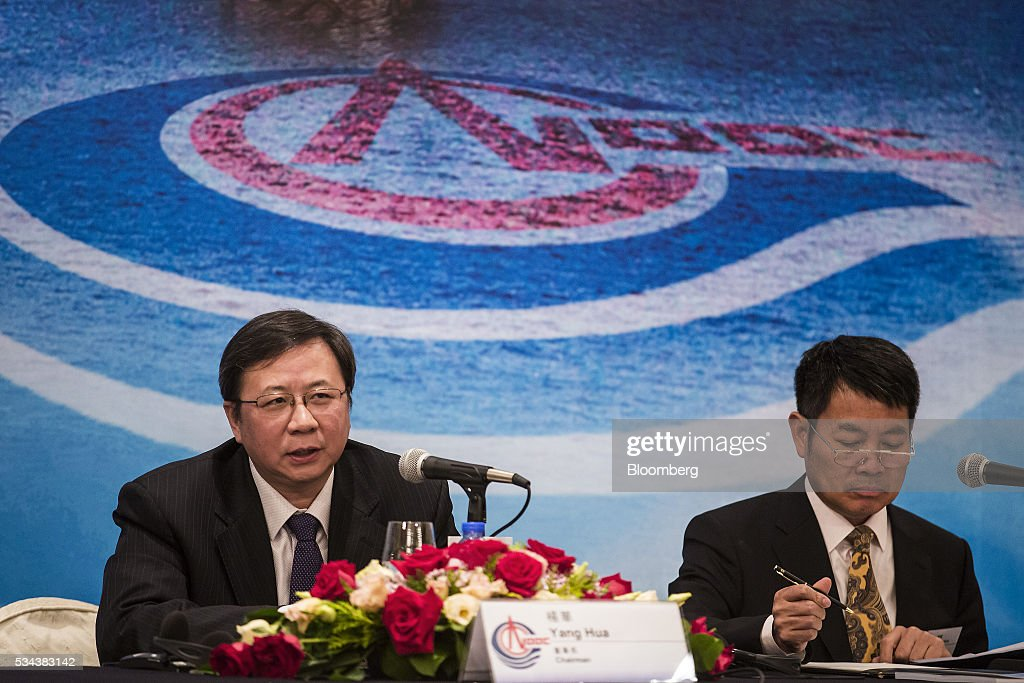 Yang Hua, chairman of Cnooc Ltd., left, speaks as Zhong Hua, chief financial officer, looks on during a news conference following the company's annual general meeting in Hong Kong, China, on Thursday, May 26, 2016. Cnooc operates in the South China Sea in accordance with China's rules and regulations, Yang said after a shareholder meeting in Hong Kong. Photographer: Justin Chin/Bloomberg via Getty Images