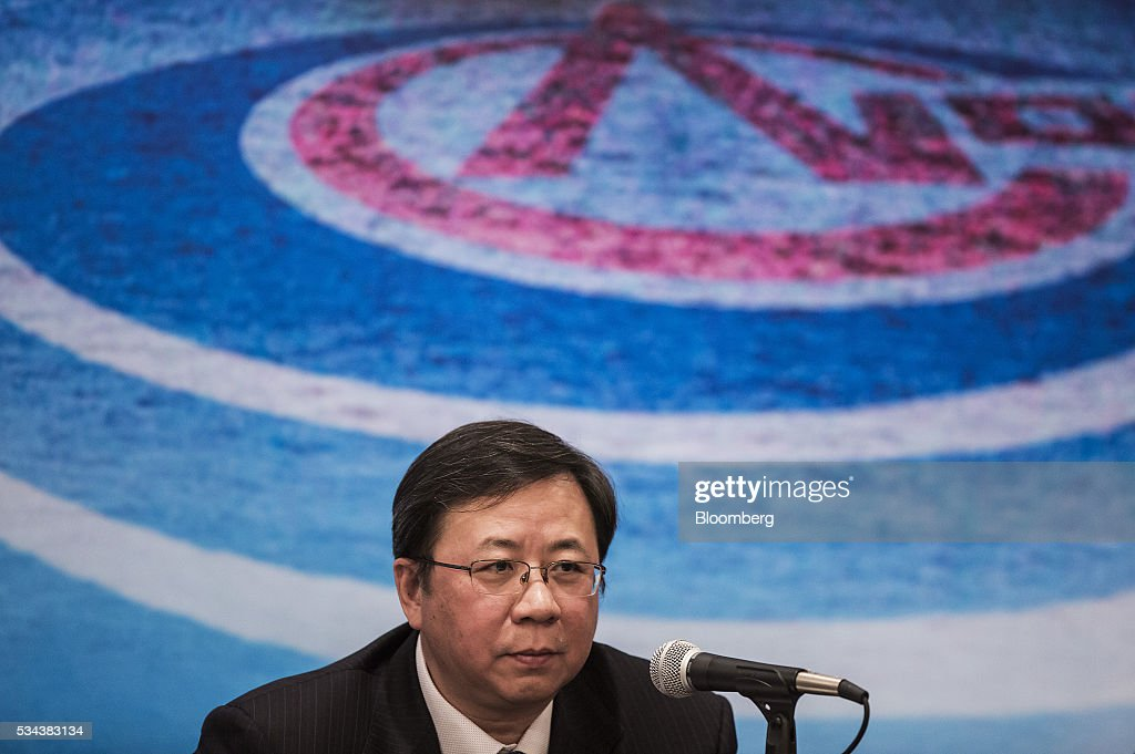 Yang Hua, chairman of Cnooc Ltd., listens during a news conference following the company's annual general meeting in Hong Kong, China, on Thursday, May 26, 2016. Cnooc operates in the South China Sea in accordance with China's rules and regulations, Yang said after a shareholder meeting in Hong Kong. Photographer: Justin Chin/Bloomberg via Getty Images