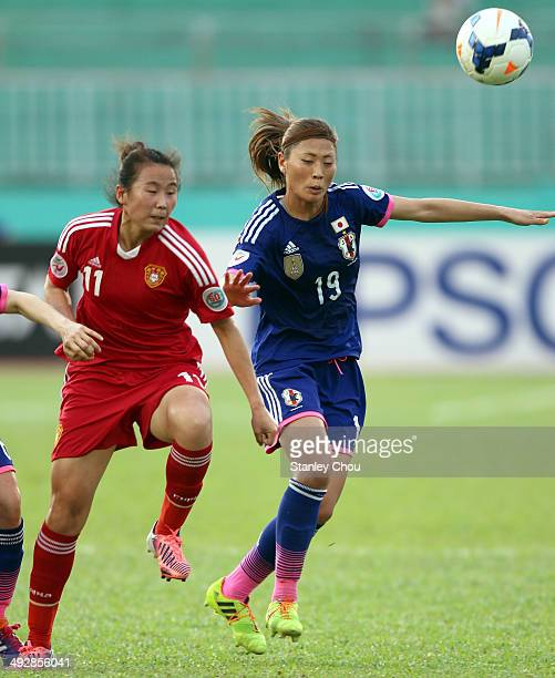 Yang Li of China battles with Rumi Utsugi of Japan during the AFC Women's Asian Cup Semi Final match between Japan and China at Thong Nhat Stadium on...