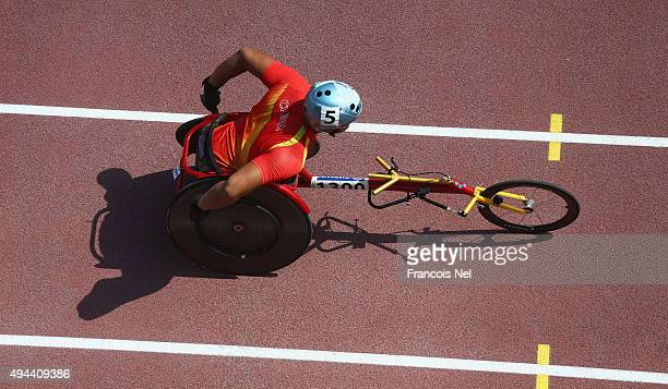 Yang Liu of China competes in the men's 400m T54 heats during the Morning Session on Day Six of the IPC Athletics World Championships at Suhaim Bin...
