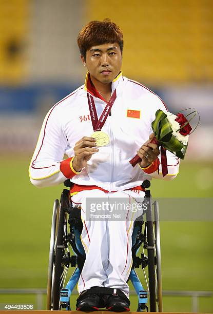 Yang Liu of China poses with his gold medal after the men's 400m T54 during the Evening Session on Day Six of the IPC Athletics World Championships...
