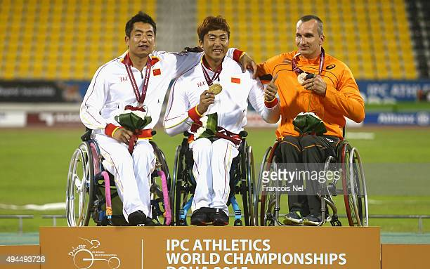 Yang Liu of China poses with his gold medal Chengming Liu of China silver and Kenny van Weeghel of Holland bronze after the men's 400m T54 during the...
