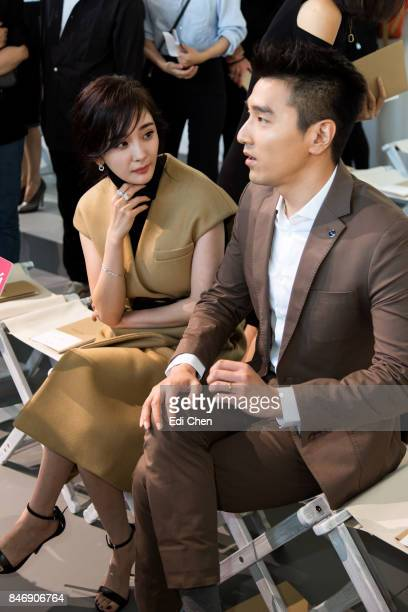 Yang Mi Mark Zhao attend the Michael Kors runway show during New York Fashion Week at Spring Studios on September 13 2017 in New York City