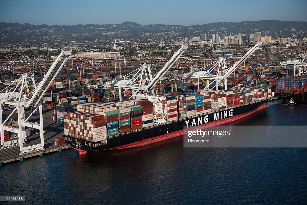 A Yang Ming Marine Transport Corp. container ship sits docked at the Port of Oakland in this aerial photograph taken above Oakland, California, U.S., on Monday, Oct. 5, 2015. With tech workers flooding San Francisco, one-bedroom apartment rents have climbed to $3,500 a month, more than in any other U.S. city. Photographer: David Paul Morris/Bloomberg via Getty Images