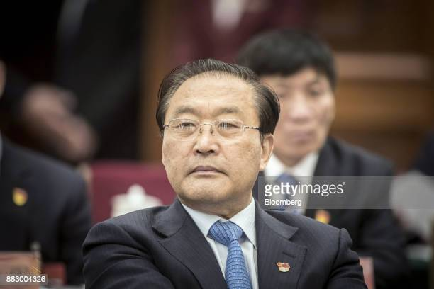 Yang Mingsheng chairman of China Life Insurance Co attends a delegation meeting at the Great Hall of the People during the 19th National Congress of...