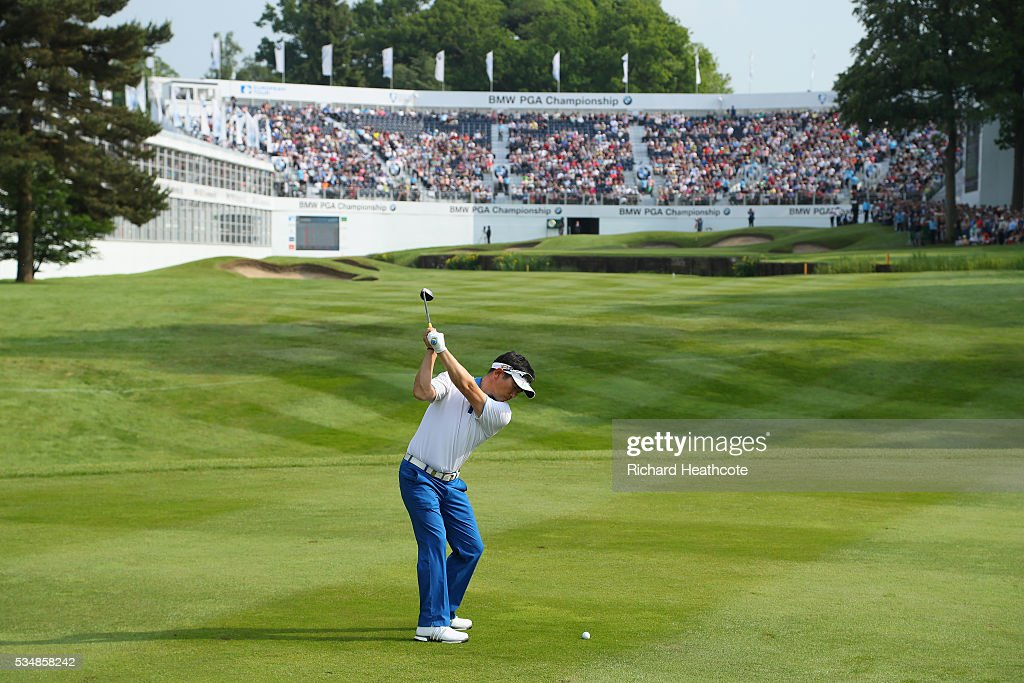 E Yang of Korea hits his 2nd shot on the 18th hole during day three of the BMW PGA Championship at Wentworth on May 28 2016 in Virginia Water England