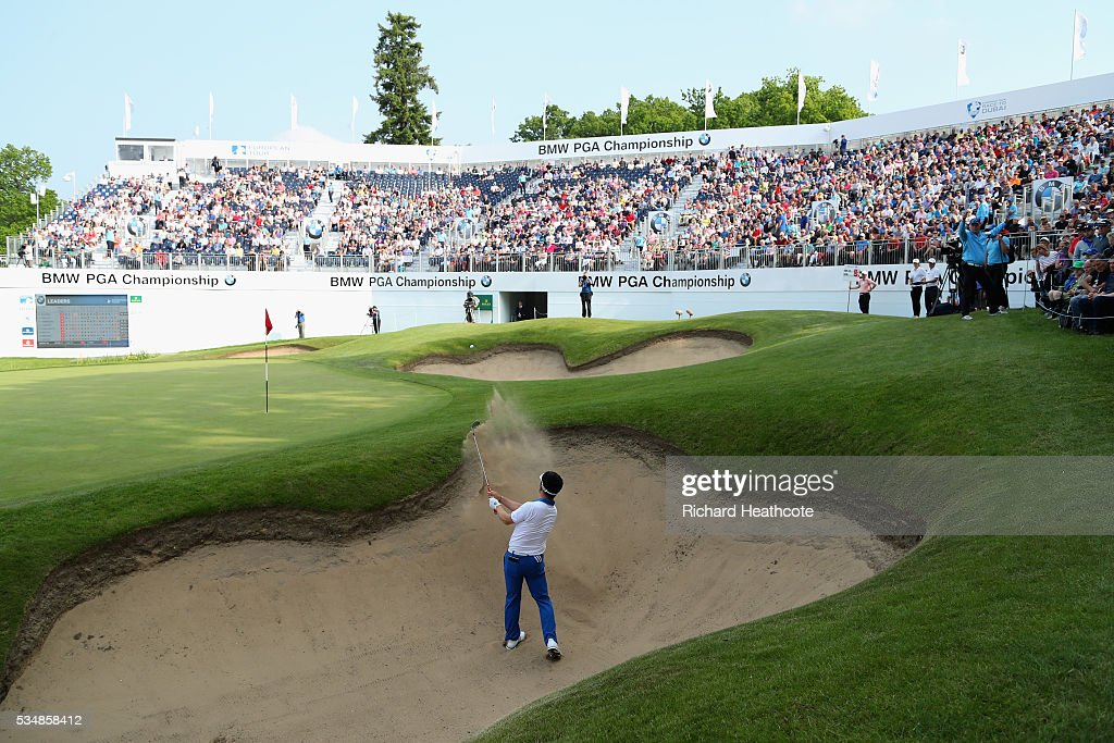 Y.E. Yang of Korea hits his 3rd shot on the 18th hole during day three of the BMW PGA Championship at Wentworth on May 28, 2016 in Virginia Water, England.