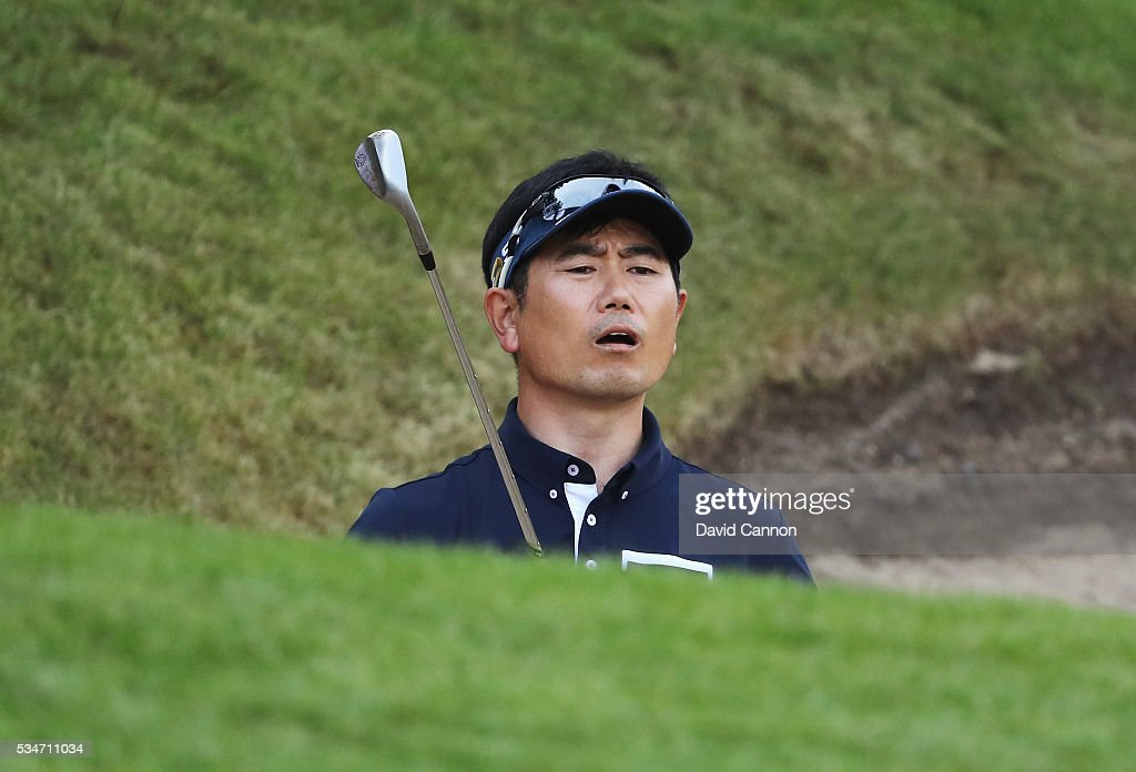 Y.E. Yang of Korea reacts to a bunker shot during day two of the BMW PGA Championship at Wentworth on May 27, 2016 in Virginia Water, England.