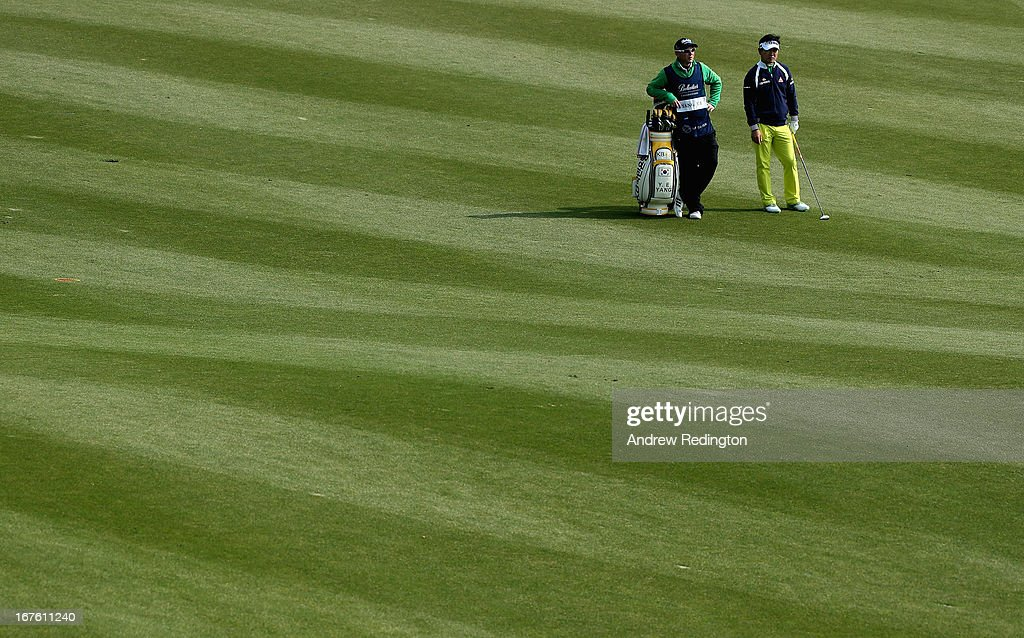 YE Yang of Korea waits with his caddie on the 18th hole during the completion of the second round of the Ballantine's Championship at Blackstone Golf Club on April 27, 2013 in Icheon, South Korea.