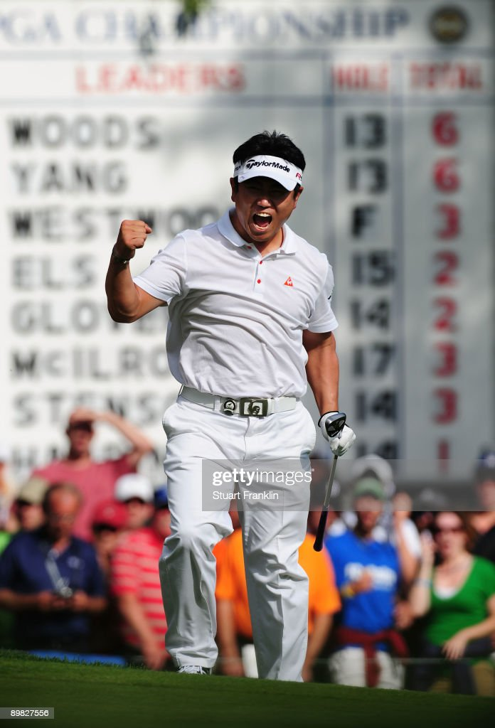 E Yang of South Korea celebrates after holing out for eagle on the 14th hole during the final round of the 91st PGA Championship at Hazeltine...