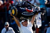 E Yang of South Korea celebrates his threestroke victory on the 18th green during the final round of the 91st PGA Championship at Hazeltine National...