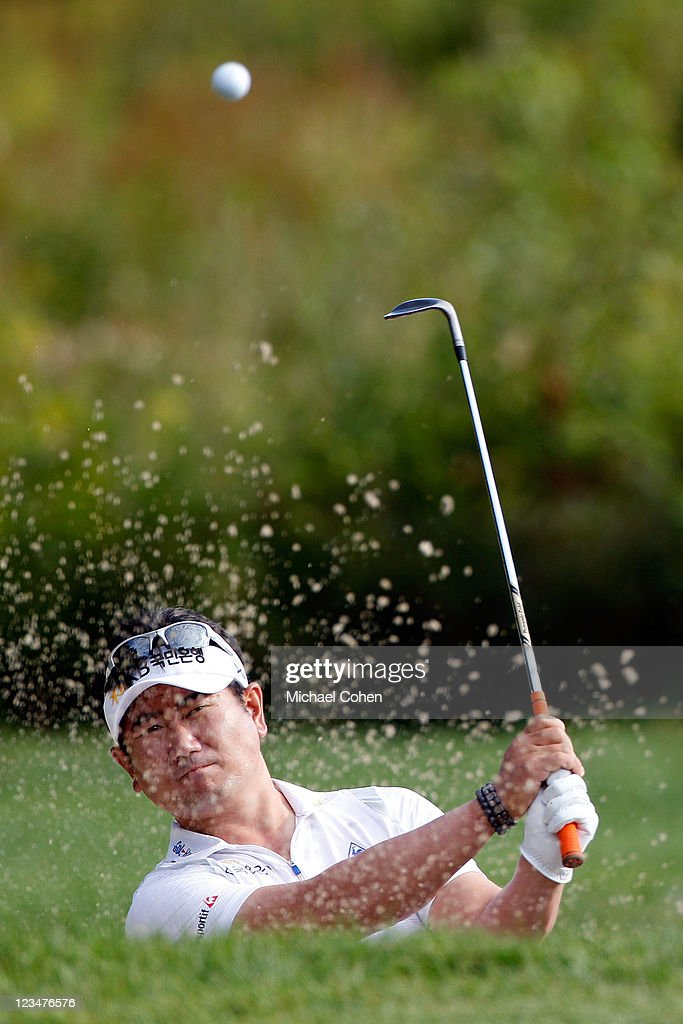 E Yang of South Korea hits a shot out of the bunker on the third hole during the second round of the Deutsche Bank Championship at TPC Boston on...