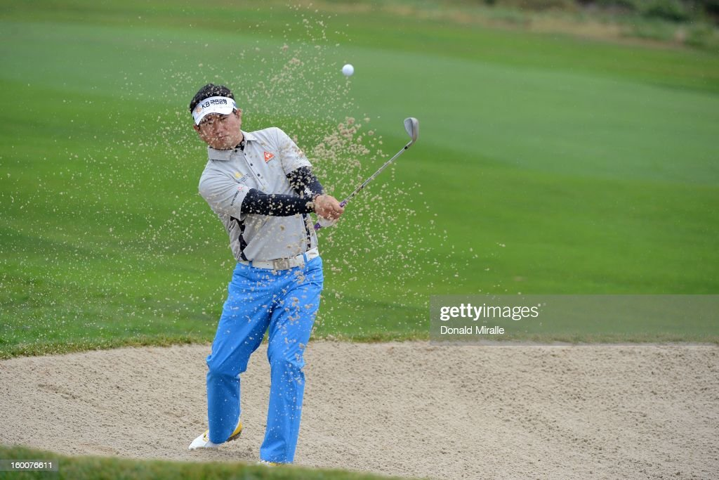 Y.E. Yang of South Korea hits out of the bunker during the first round at the Farmers Insurance Open at Torrey Pines North Golf Course on January 25, 2013 in La Jolla, California.
