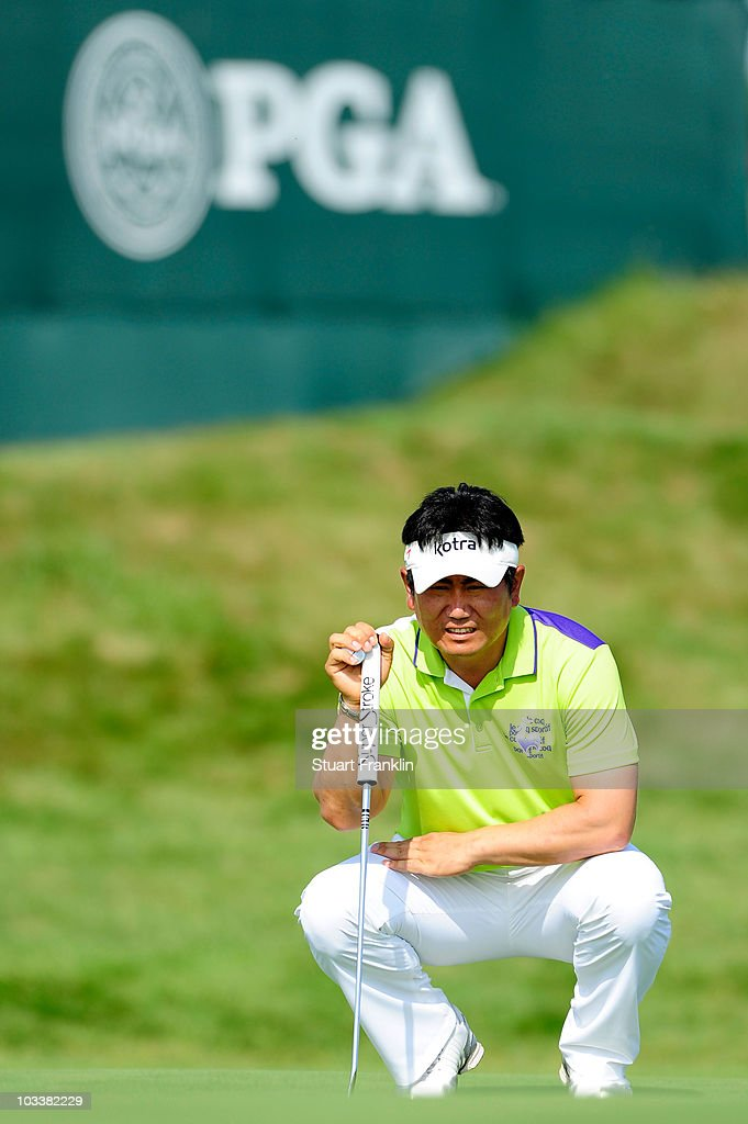 E Yang of South Korea lines up a putt on the 15th hole during the continuation of the second round of the 92nd PGA Championship on the Straits Course...