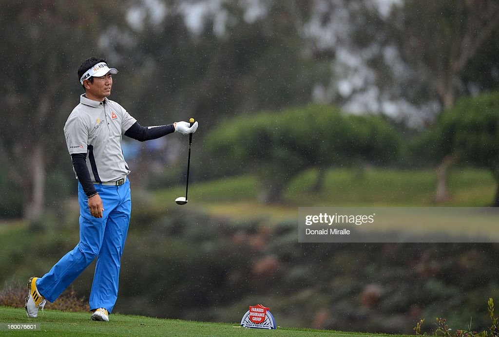 Y.E. Yang of South Korea looks onto the fairway after hitting off the tee box during the first round at the Farmers Insurance Open at Torrey Pines North Golf Course on January 25, 2013 in La Jolla, California.