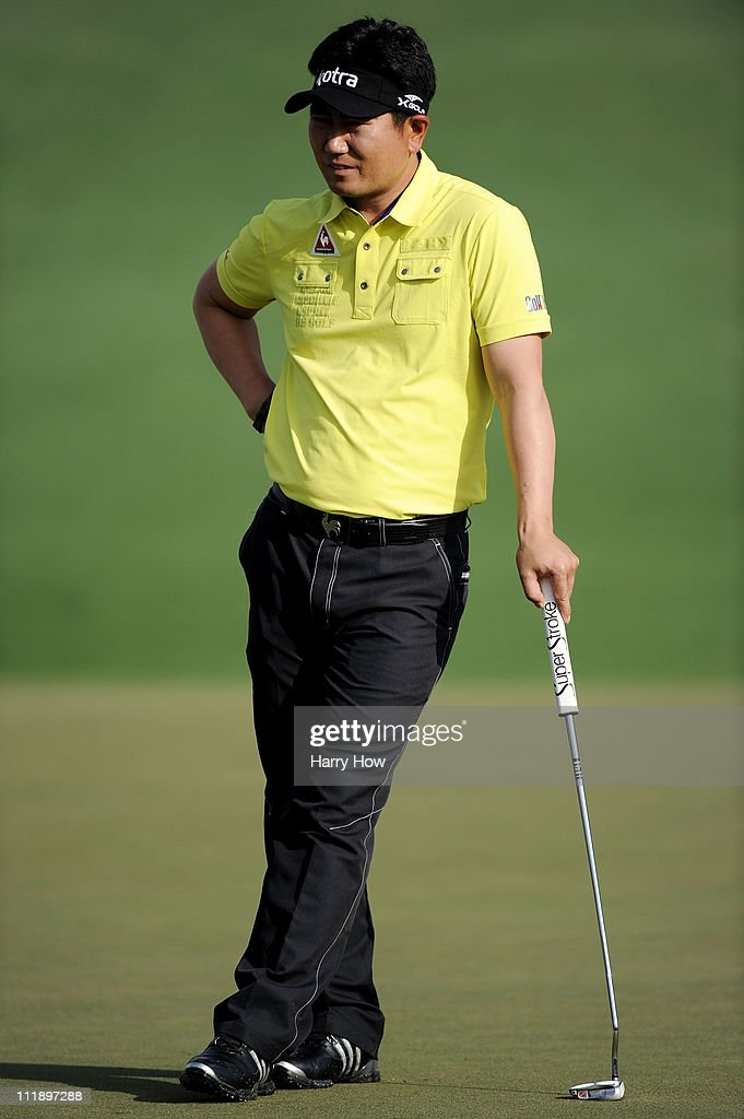 E Yang of South Korea waits on the second green during the second round of the 2011 Masters Tournament at Augusta National Golf Club on April 8 2011...