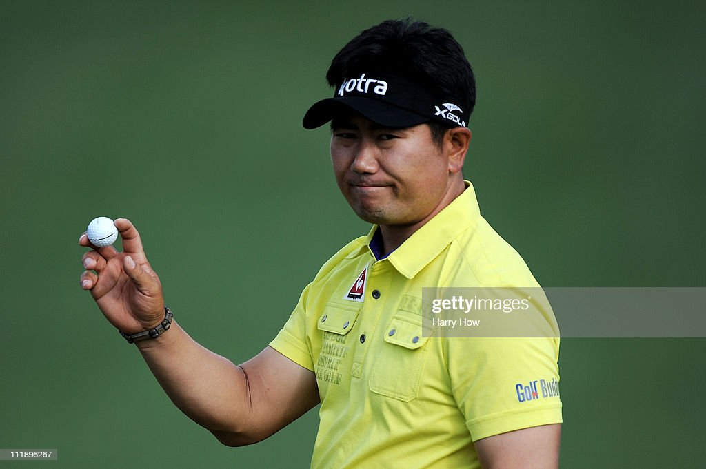 E Yang of South Korea waves to the gallery on the second green during the second round of the 2011 Masters Tournament at Augusta National Golf Club...