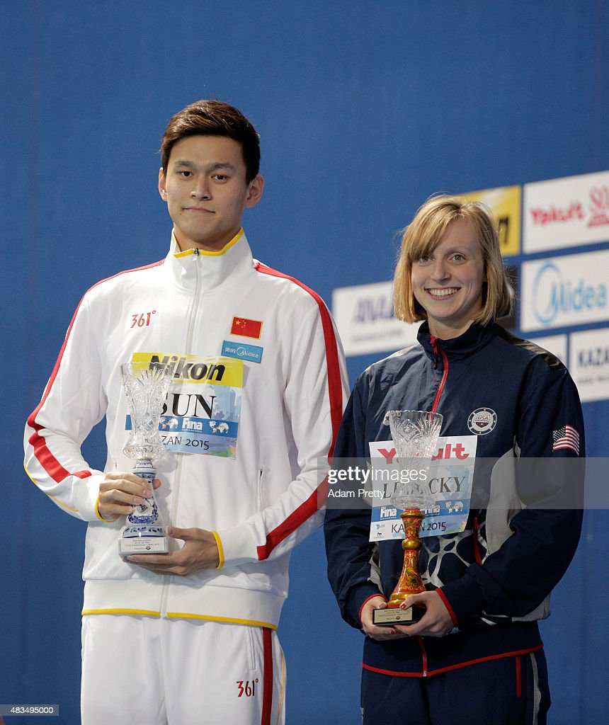 Yang Sun of China and <a gi-track='captionPersonalityLinkClicked' href=/galleries/search?phrase=Katie+Ledecky&family=editorial&specificpeople=9595921 ng-click='$event.stopPropagation()'>Katie Ledecky</a> of the United States pose with their Best Male and Best Female swimmer awards on day sixteen of the 16th FINA World Championships at the Kazan Arena on August 9, 2015 in Kazan, Russia.