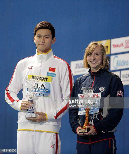 Yang Sun of China and Katie Ledecky of the United States pose with their Best Male and Best Female swimmer awards on day sixteen of the 16th FINA...