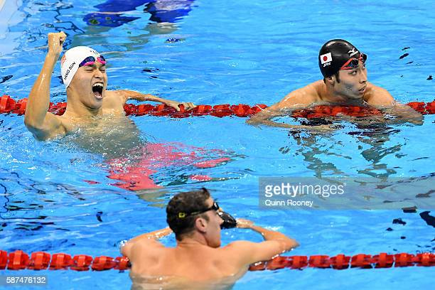 Yang Sun of China celebrates winning gold in the Men's 200m Freestyle Final on Day 3 of the Rio 2016 Olympic Games at the Olympic Aquatics Stadium on...