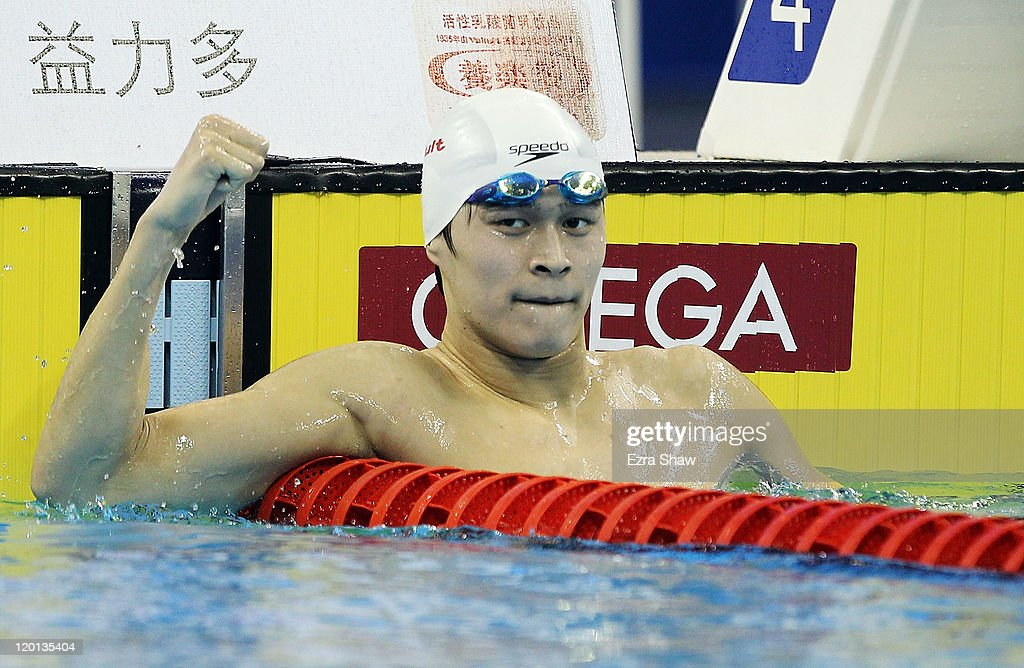 Yang Sun of China celebrates winning the gold medal in a new world record in the Men's 1500m Freestyle Final during Day Sixteen of the 14th FINA World Championships at the Oriental Sports Center on July 31, 2011 in Shanghai, China.